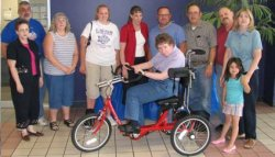 Julie Lewis with her AmTryke Therapeutic Tricycle