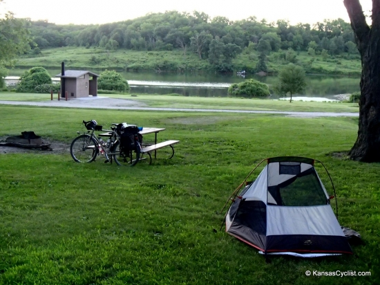 Atchison State Fishing Lake - Campsite - This is a typical campsite at Atchison State Fishing Lake, with a picnic table, fire ring, grass for tents, and plenty of shade, with nearby access to restrooms and the lake.