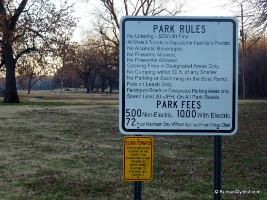 Baxter Springs Riverside Park - Park Rules - This sign at the entrance to Baxter Springs Riverside Park lists the rules for the park. Note that camping is not allowed within 30 feet of any shelter, and the tent camping rate is $5 per night.