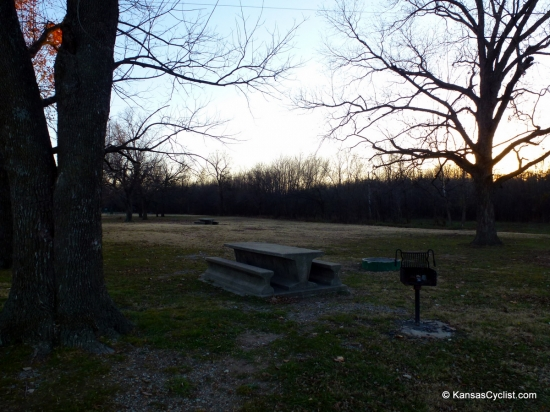 Baxter Springs Riverside Park - Campsite - This is a typical campsite at Baxter Springs Riverside Park, with a concrete picnic table, grill, and fire ring.