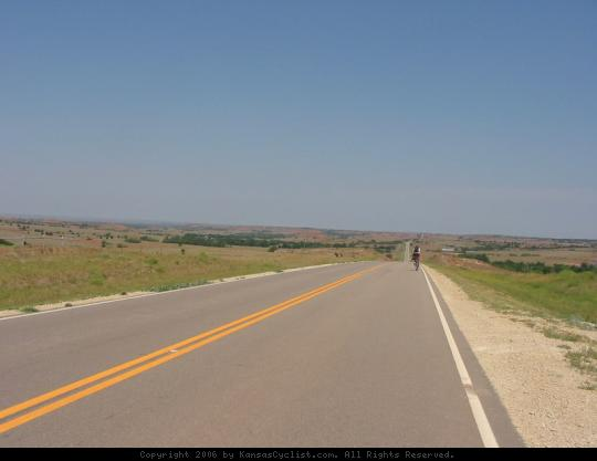 Biking Across Kansas 2006 - A cyclist pedals through the Gypsum Hills on Hwy 160 west of Medicine Lodge.