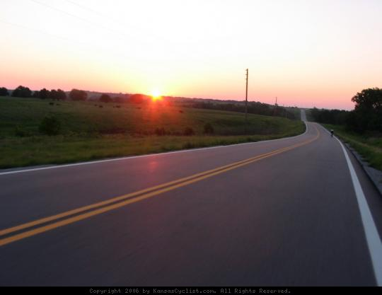 Biking Across Kansas 2006 - Sunrise leaving Burden, Kansas on Hwy 160.