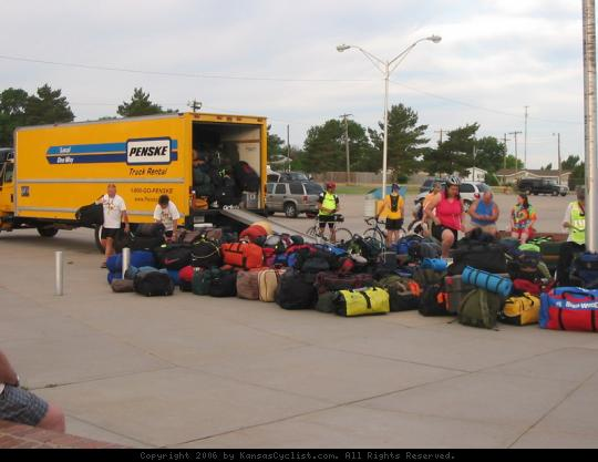 Biking Across Kansas 2006 - Loading the luggage truck in Johnson City.