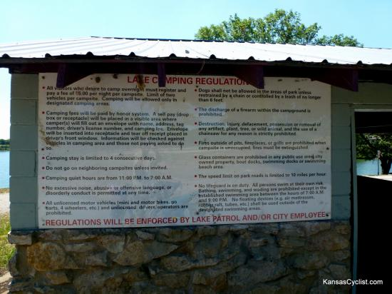 Lake Fort Scott - Regulations - This sign, affixed to the picnic shelter, details the rules and regulations in the camping area at Lake Fort Scott. The cost for camping is $5 per night, paid on the honor system via self-pay envelopes and a lock-box (located in the shelter).