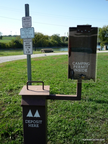 Garnett North Lake Park - Self-Pay Station - This is the Self-Pay Station in the campground at North Lake Park in Garnett, Kansas. The top box contains permits, which must be filled out (no pen provided) and deposited with the camping fee in the lower box.