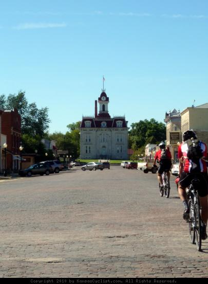 Bicyclists in Cottonwood Falls, Kansas - A groups of bicyclists ride the brick streets towards the historic courthouse in Cottonwood Falls, Kansas.