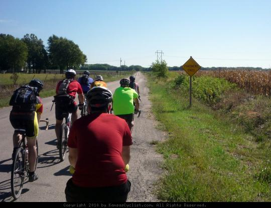 Pavement Ends - A groups of bicyclists contemplate the end of the pavement and the start of a gravel road in Chase County, Kansas.