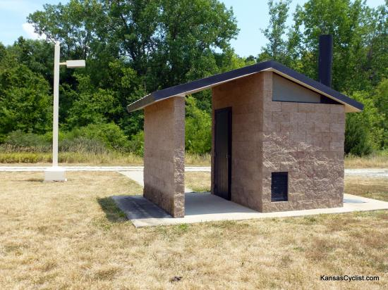 La Cygne Wildlife Area - Restroom - There is a single restroom available near the primitive camping area at La Cygne Wildlife Area. It is a pit toilet, but there is no water, and no electricity (despite the automatic lamp shown).