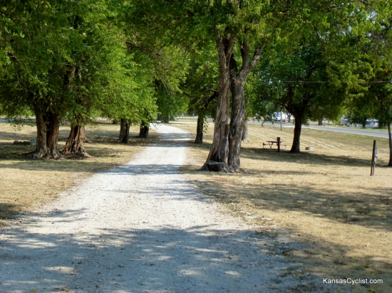 Lake Miola - Camping Area - This is one of the camping areas at Lake Miola. There are picnic tables, fire rings, grassy areas, and shade trees.