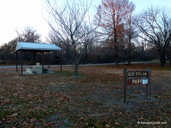 Old Route 66 Park - Entrance - This is the entrance sign for Old Route 66 Park, a roadside park located near Baxter Springs, Kansas along historic Route 66. Shown in the background is one of the many shelters and picnic tables in the park.