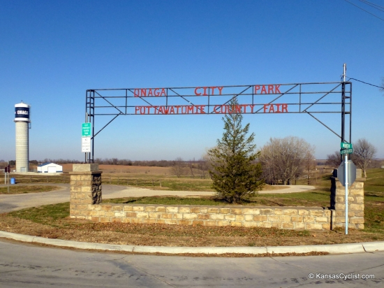 Onaga City Park - Entrance Sign - This is the entrance sign for Onaga City Park and the Pottawatomie County Fair Grounds. The tent camping area is located down the hill in the copse of trees in the background of this photo.