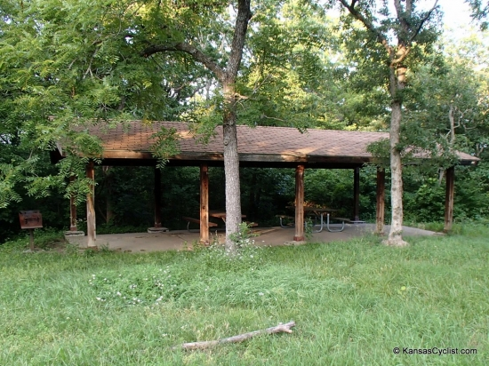 Old Military Trail Campground - Shelter - This is the shelter at the Old Military Trail Campground at Perry Lake. It includes picnic tables, a grill, and fire ring. There is grass nearby, and along the access road, for tenting.