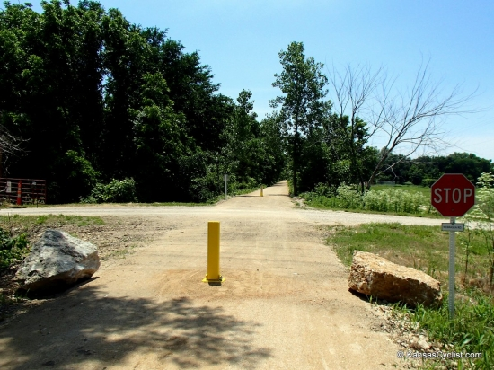 Southwind Rail Trail - Road Crossing - This is a typical road crossing on the Southwind Rail Trail, with bollards to keep out motor vehicle traffic. Road traffic has right-of-way.