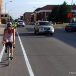 Cyclists riding the new Hays bike lanes.