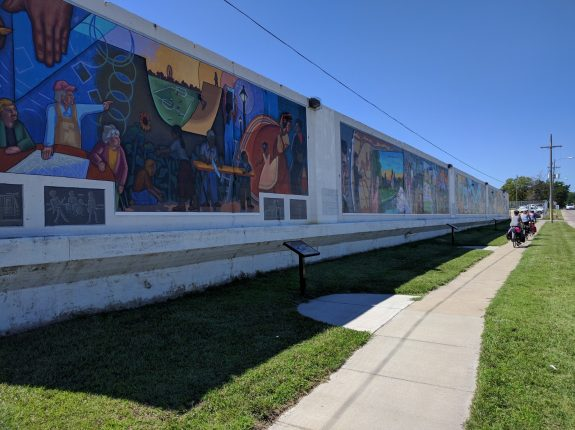 Appreciating the Art Mural Wall in downtown Topeka.