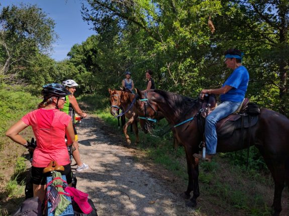 Bicyclists and equestrians on the Flint Hills Nature Trail near Rantoul. With mutual respect and care, it's easy to share the trail!