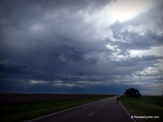 Storm clouds gather, bringing a few raindrops, between Gorham and Russell