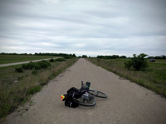 "Slog: This section of the Prairie Spirit Trail, between Welda and Colony, often becomes a ""death march"", and it did for me. Hemmed in by US-169 on the west, and a gravel road on the east, and straight and flat with little tree cover, this section really dragged for me."