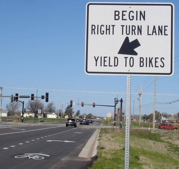 It can be hard to safely mix right turn lanes with bike lanes. The city made a good decision to use sharrows and signs to make clear that cyclists going straight have the right of way.