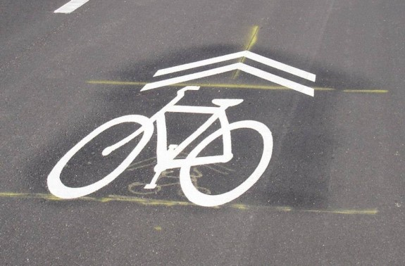 We will need to educate motorists what this sign means: bicyclists may use any portion of the full width of the lane.